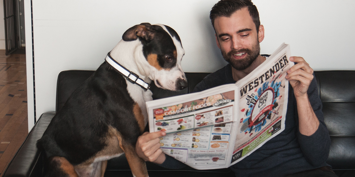 Pickles and Mike reading the Westender at Blu Realty